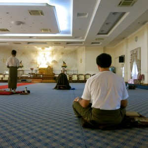 Foreign Yogis continuing their practice in the main meditation hall after during a break time.
