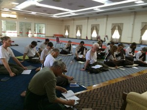 Group Dhamma Training session during the retreat in the main meditation Hall, MSY.